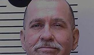 In this Nov. 16, 2018, photo released by the California Department of Corrections and Rehabilitation, CDCR, shows inmate David Reed. The California death row inmate at San Quentin State Prison has died from apparent complications of the coronavirus in the midst of an outbreak that has infected about 40% of inmates at the prison, corrections officials said Wednesday, July 8, 2020. (California Department of Corrections and Rehabilitation via AP)
