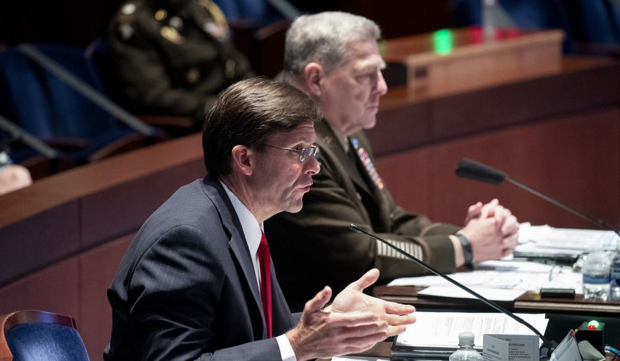 Defense Secretary Mark Esper testifies during a House Armed Services Committee hearing on Thursday, July 9, 2020, on Capitol Hill in Washington. Chairman of the Joint Chiefs of Staff Gen. Mark Milley listens at right. (Michael Reynolds/Pool via AP)