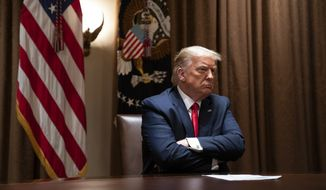 President Donald Trump listens during a meeting with Hispanic leaders in the Cabinet Room of the White House, Thursday, July 9, 2020, in Washington. (AP Photo/Evan Vucci) **FILE**