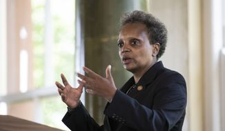 "Chicago Mayor Lori Lightfoot announces the ""Forward Together, Building a Stronger Chicago"" report from the city's COVID-19 Recovery Task Force at the South Shore Cultural Center, Thursday, July 9, 2020. (Ashlee Rezin Garcia/Chicago Sun-Times via AP)"