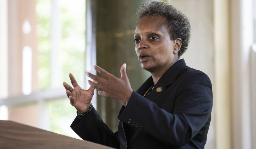 "Chicago Mayor Lori Lightfoot announces the ""Forward Together, Building a Stronger Chicago"" report from the city's COVID-19 Recovery Task Force at the South Shore Cultural Center, Thursday, July 9, 2020. (Ashlee Rezin Garcia/Chicago Sun-Times via AP) **FILE**"