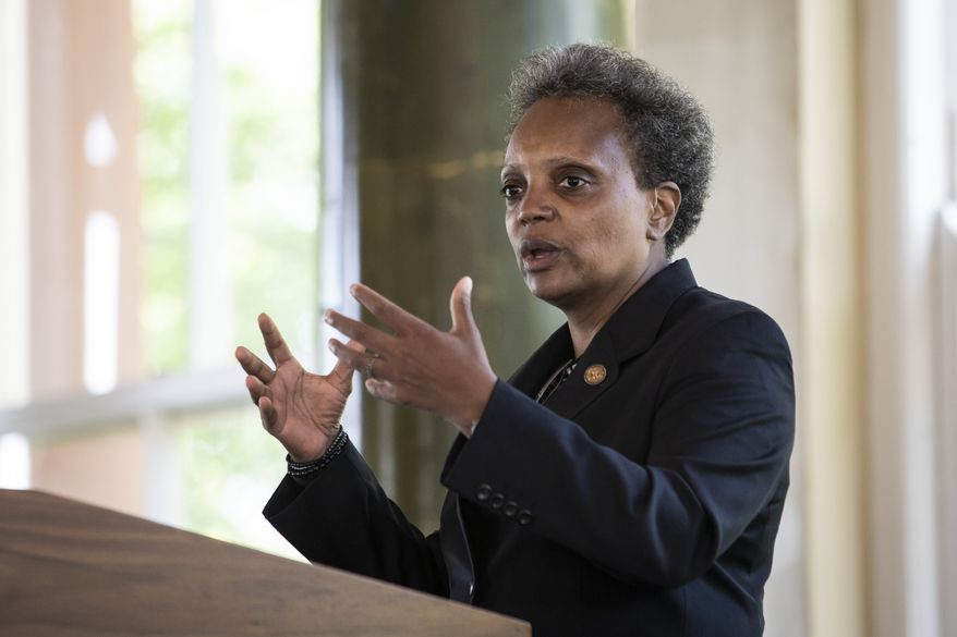 """Chicago Mayor Lori Lightfoot announces the """"Forward Together, Building a Stronger Chicago"""" report from the city's COVID-19 Recovery Task Force at the South Shore Cultural Center, Thursday, July 9, 2020. (Ashlee Rezin Garcia/Chicago Sun-Times via AP) **FILE**"""