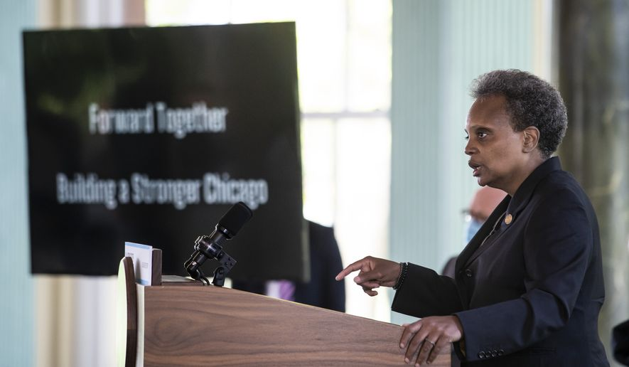 """Mayor Lori Lightfoot announces the """"Forward Together, Building a Stronger Chicago"""" report from the city's COVID-19 Recovery Task Force at the South Shore Cultural Center, Thursday, July 9, 2020. (Ashlee Rezin Garcia/Chicago Sun-Times via AP)"""