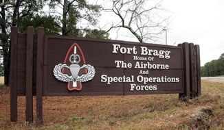 In this Jan. 4, 2020, file photo a sign for at Fort Bragg, N.C., is shown. (AP Photo/Chris Seward, File)