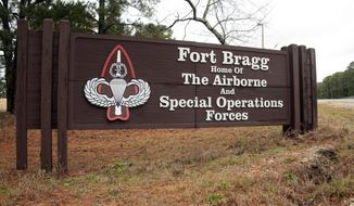 In this Jan. 4, 2020, file photo a sign for at Fort Bragg, N.C., is shown. (AP Photo/Chris Seward, File) ** FILE **