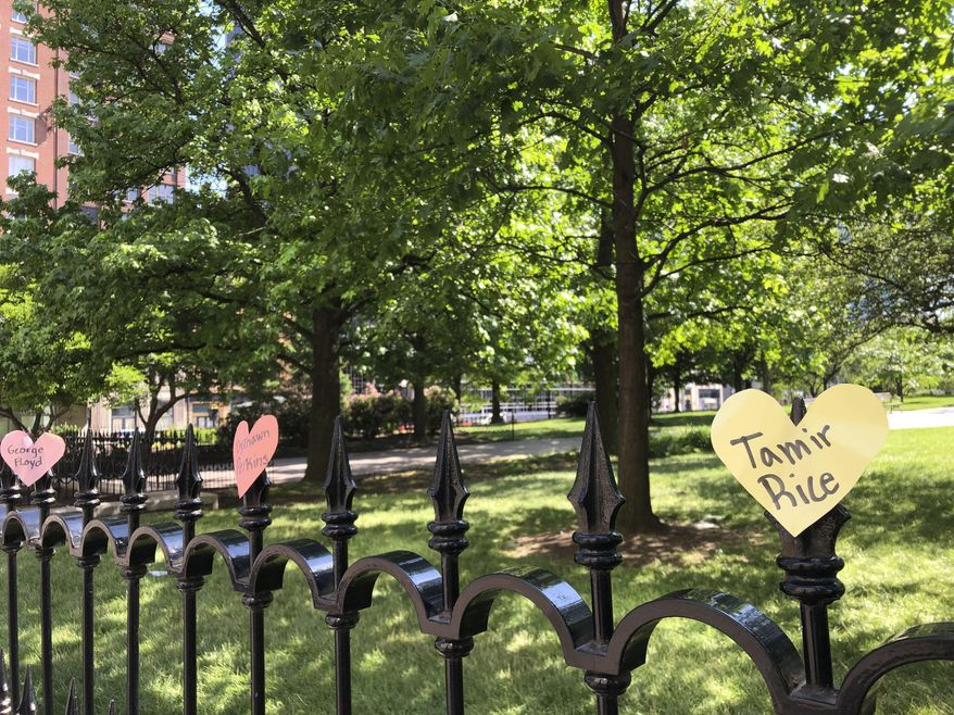 Hearts with the names of black people who died at the hands of police are displayed on a fence as part of a protest at the Ohio Statehouse in Columbus, Ohio, on Saturday, June 6, 2020. People are protesting racial injustice and police brutality after the death of George Floyd, a black man, who died after he was restrained by Minneapolis police on May 25. (AP Photo/Julie Carr Smyth)