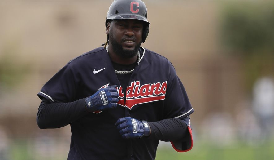FILE - In this Friday, Feb. 28, 2020 file photo, Cleveland Indians' Franmil Reyes reacts after hitting a home run during the second inning of a spring training baseball game against the Chicago White Sox in Glendale, Ariz. Franmil Reyes' first error this season was in judgment. The Indians' free-swinging slugger and outfielder apologized Thursday, July 9, 2020 for endangering his health and his teammates' for not wearing a mask while attending a holiday party last weekend. (AP Photo/Gregory Bull, File)