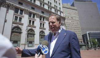 In this June 20, 2020, file photo, Geoffrey S. Berman, then-U.S. attorney for the Southern District of New York, speaks to reporters as he arrives at his office in New York. (AP Photo/Kevin Hagen, File)