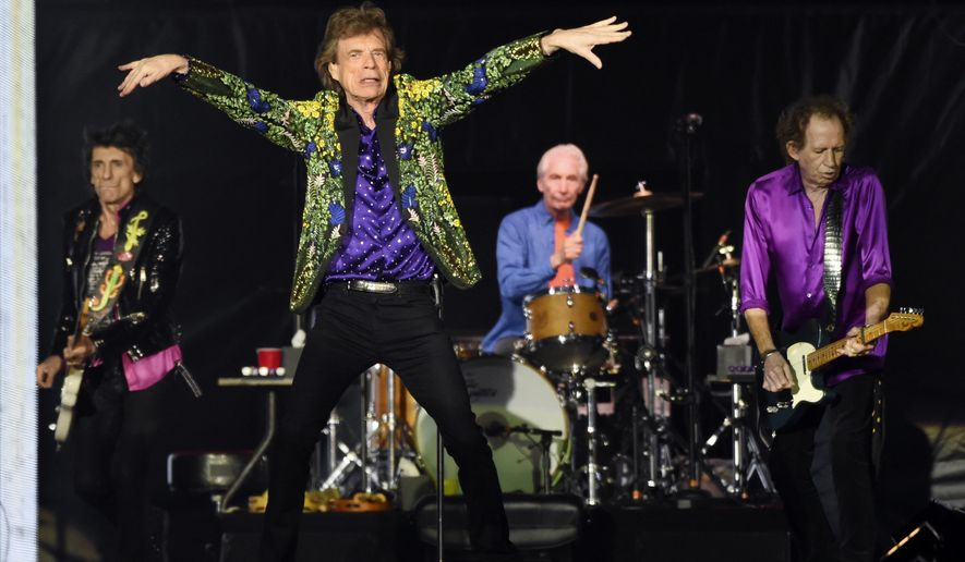 Ron Wood, from left, Mick Jagger, Charlie Watts and Keith Richards of the Rolling Stones perform during their concert in Pasadena, Calif. (Photo by Chris Pizzello/Invision/AP, File)
