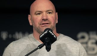 FILE - In this Nov. 2, 2018, file photo, UFC president Dana White speaks at a news conference in New York. When White first proposed holding mixed martial arts fights on an isolated island during the early weeks of the worldwide sports shutdown, fans and haters alike imagined waves lapping at an octagon perched amid palm trees on a white sand beach. A few months later, the project that came to be known as Fight Island is real, and ready for competition. And while it's not literally on a beach, the octagon at Abu Dhabi's Yas Island is inside a bubble that seems highly unlikely to burst. (AP Photo/Julio Cortez, File)