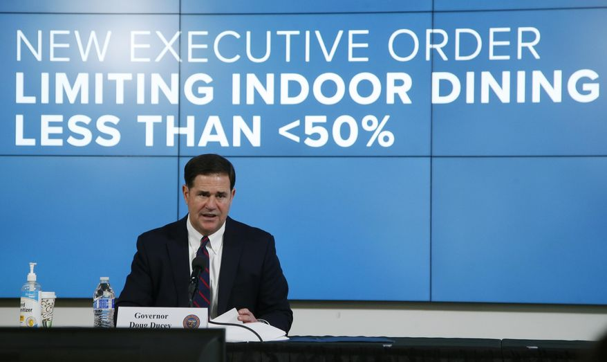 Arizona Republican Gov. Doug Ducey talks about an executive order as he speaks about the latest coronavirus information at a news conference, Thursday, July 9, 2020, in Phoenix. (AP Photo/Ross D. Franklin, Pool)