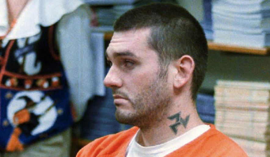 In this Oct. 31, 1997, file photo, Daniel Lewis Lee waits for his arraignment hearing for murder in the Pope County Detention Center in Russellville, Ark. (Dan Pierce/The Courier via AP, File)