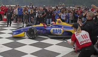 IndyCar Rev Group Grand Prix winner Alexander Rossi enters Victory Lane Sunday, June 23, 2019, at Road America in Elkhart Lake, Wis. The IndyCar series will welcome fans for the first time of the year during the REV Group Grand Prix doubleheader Saturday and Sunday, July 11-12, 2020,  at Road America in Plymouth, Wisconsin.(Gary C. Klein/The Sheboygan Press via AP)