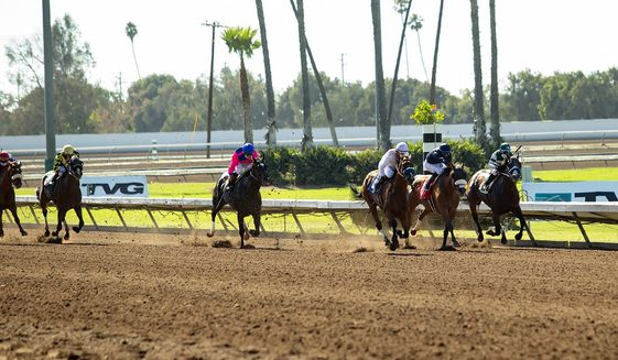 In this image provided by Benoit Photo, Sneaking Out, third from right, with Martin Garcia aboard, wins the Grade II, $200,000 Great Lady M Stakes horse race Saturday, July 4, 2020, at Los Alamitos Race Course in Cypress, Calif. (Benoit Photo via AP)