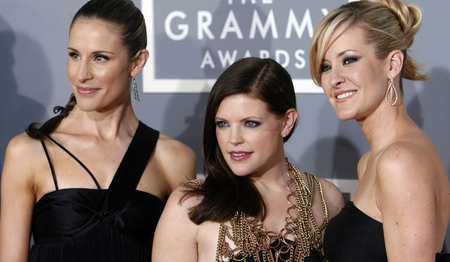 """FILE - In this Feb. 11, 2007 file photo, the Dixie Chicks, Emily Robison, left, Natalie Maines, center, and Martie Maguire arrive for the 49th Annual Grammy Awards in Los Angeles. The Grammy-winning country group, who recently changed their name to The Chicks, have a new album """"Gaslighter"""" out July 17, 2020. (AP Photo/Matt Sayles, File)"""