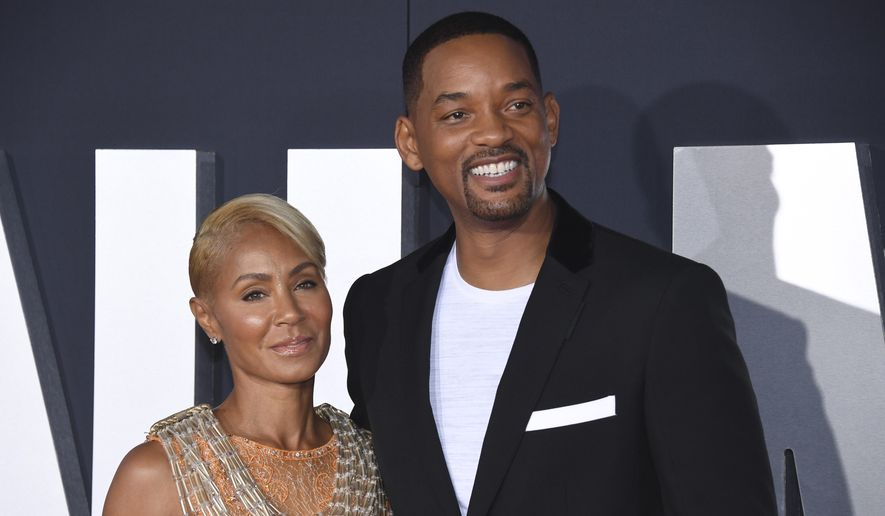 "In this Oct. 6, 2019, file photo, Jada Pinkett Smith, left, and her husband Will Smith attend the premiere of ""Gemini Man"" in Los Angeles. Pinkett Smith has admitted to having a relationship with musician August Alsina when she and her husband were separated. In a conversation on her series ""Red Table Talk,"" she said she was reluctantly discussing Alsina's comments because of the public speculation they provoked. Will Smith appeared on the show to discuss the chapter in their lives. (Photo by Phil McCarten/Invision/AP, File)"