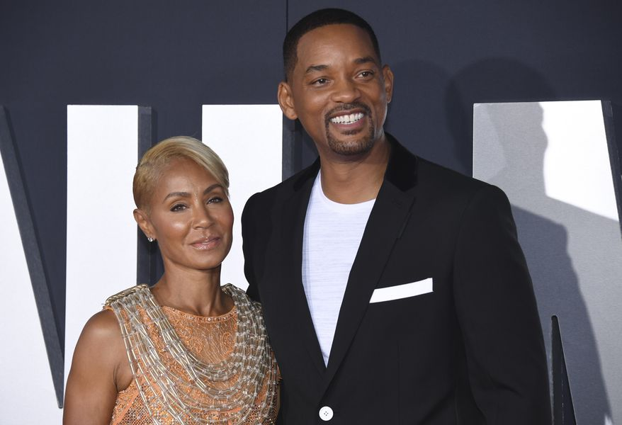 """In this Oct. 6, 2019, file photo, Jada Pinkett Smith, left, and her husband Will Smith attend the premiere of """"Gemini Man"""" in Los Angeles. Pinkett Smith has admitted to having a relationship with musician August Alsina when she and her husband were separated. In a conversation on her series """"Red Table Talk,"""" she said she was reluctantly discussing Alsina's comments because of the public speculation they provoked. Will Smith appeared on the show to discuss the chapter in their lives. (Photo by Phil McCarten/Invision/AP, File)"""