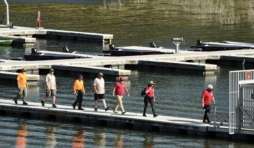 """Search and rescue personnel exit the pier at Lake Piru in Los Padres National Forest, Calif., Thursday, July 9, 2020. Authorities said Thursday that they believe """"Glee"""" star Naya Rivera drowned in the lake but they are continuing the search for her a day after her 4-year-old son was found alone in a rented boat. (AP Photo/Chris Pizzello)"""