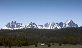 FILE - This June 1, 2012 file photo, shows the Sawtooth National Recreation Area near Stanley, Idaho. The U.S. Department of Justice has dropped its request asking a federal judge to prohibit an Idaho man from flying his helicopter near work crews building a public trail on an easement crossing private land in central Idaho. (Darin Oswald/Idaho Statesman via AP, File)