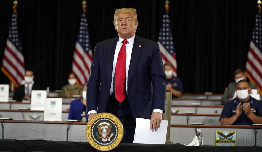 President Donald Trump stands after a briefing on counternarcotics operations at U.S. Southern Command, Friday, July 10, 2020, in Doral, Fla. (AP Photo/Evan Vucci)