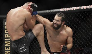 Jorge Masvidal, right, punches Nate Diaz during the second round of a welterweight mixed martial arts bout at UFC 244 in New York, Nov. 3, 2019. (AP Photo/Frank Franklin II) ** FILE **