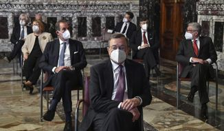 Former European Central Bank President, Mario Draghi, foreground, listens to the Bank of Italy annual speech in Rome, Friday, May 29, 2020. (Alessandro Di Meo/Pool Photo via AP)
