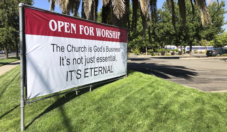 "An ""Open for Worship"" banner is posted outside the Crossroads Community Church in Yuba City, Calif., Thursday, July 9, 2020. (AP Photo/Adam Beam) ** FILE **"