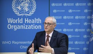 In this Jan. 23, 2020, file photo, Dr. Gauden Galea, the World Health Organization (WHO) representative in China, speaks during an interview with The Associated Press at the WHO's offices in Beijing.  (AP Photo/Mark Schiefelbein, File)  **FILE**