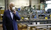 In this July 9, 2020, file photo, Democratic presidential candidate, former Vice President Joe Biden adjusts his mask during a tour of McGregor Industries, a metal fabricating facility in Dunmore, Pa. Biden is pledging to define his presidency by a sweeping economic agenda beyond anything Americans have seen since the Great Depression and the industrial mobilization for World War II. (AP Photo/Matt Slocum, File)