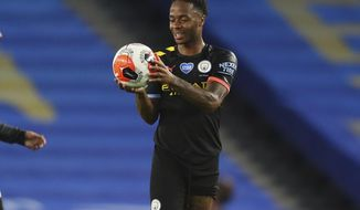 Manchester City's Raheem Sterling holds the ball at the end of the English Premier League soccer match between Brighton and Manchester City at the Falmer stadium in Brighton, England, Saturday, July 11, 2020. (Cath Ivill/Pool via AP)
