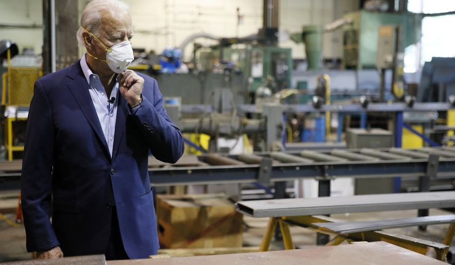 FILE - In this July 9, 2020, file photo Democratic presidential candidate, former Vice President Joe Biden adjusts his mask during a tour of McGregor Industries, a metal fabricating facility in Dunmore, Pa. Biden is pledging to define his presidency by a sweeping economic agenda beyond anything Americans have seen since the Great Depression and the industrial mobilization for World War II. (AP Photo/Matt Slocum, File)