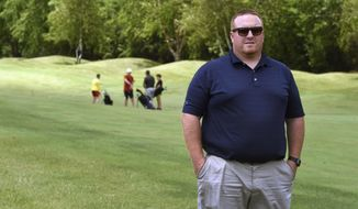 Tim Matsche, general manager of Loggers Trail, pauses on the golf course in Stillwater, Minn., on Tuesday, June 30, 2020. Since coronavirus pandemic restrictions have been eased in Minnesota, golf courses throughout the Twin Cities metro area are as packed as they have ever been. (Scott Takushi/Pioneer Press via AP)