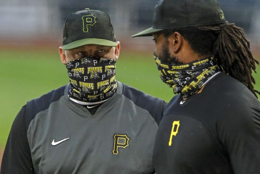 FILE - In this Tuesday, July 7, 2020, file photo, Pittsburgh Pirates first baseman Josh Bell, right, listens to manager Derek Shelton during a team workout at PNC Park in Pittsburgh. Shelton and other first-year managers are scrambling to make up for lost time. The rookie skippers are getting creative when it comes to getting a feel for their players during a season unlike any other.  (AP Photo/Gene J. Puskar, File)