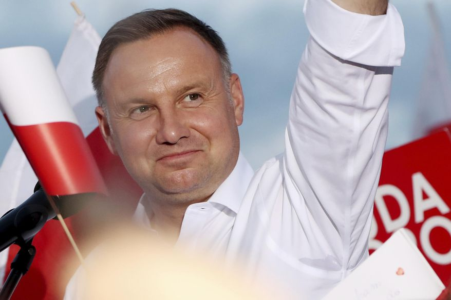 In this Tuesday, July 7, 2020 photo Poland's incumbent president Andrzej Duda, who is seeking reelection in a tight presidential election runoff on Sunday, July 12, 2020 attends a rally in Lomza, Poland. Duda, who has backing from Poland's ruling right-wing party, is running against liberal Warsaw mayor, Rafal Trzaskowski. Opinion polls suggest the election may be decided by a small number of votes. (AP Photo/Czarek Sokolowski)