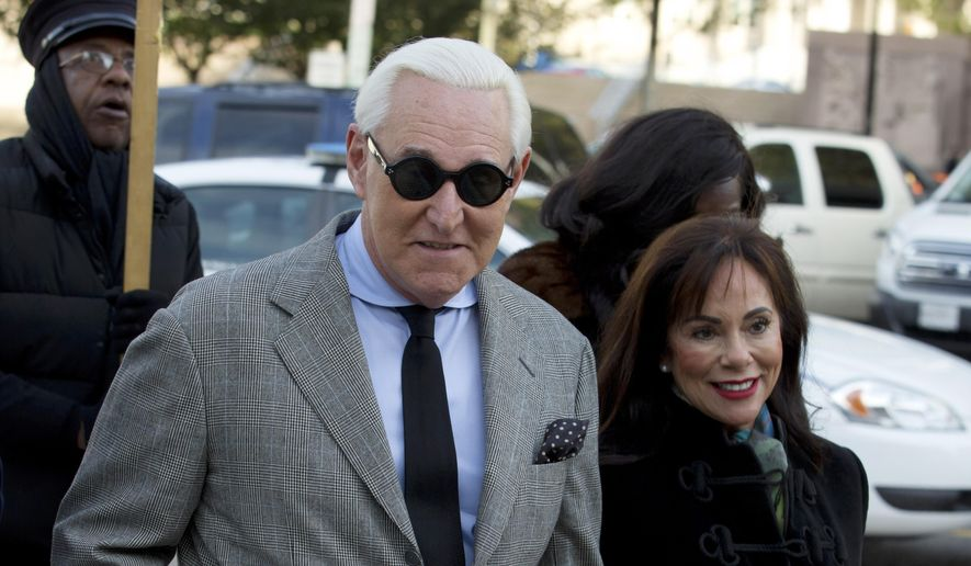 In this Nov. 14, 2019, file photo, Roger Stone accompanied by his wife Nydia Stone, right, arrives at federal court in Washington. (AP Photo/Jose Luis Magana, File)