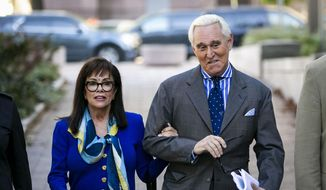 In this Nov. 8, 2019, file photo, Roger Stone, and his wife Nydia, arrive at federal court in Washington. (AP Photo/Al Drago, File)