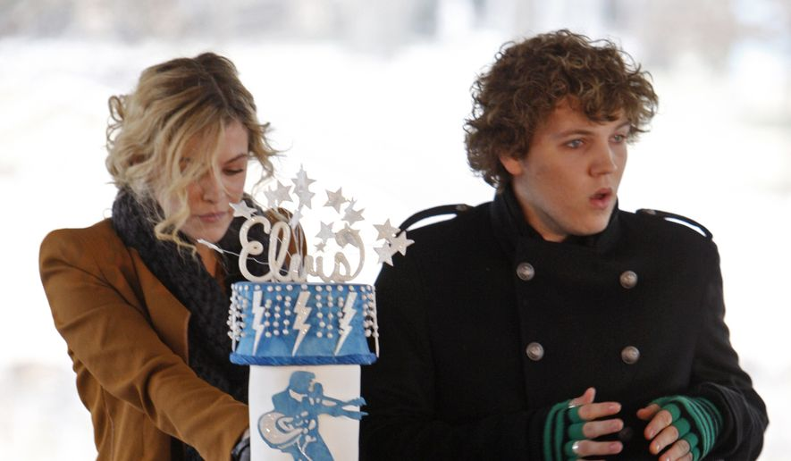 Elvis Presley's grandchildren, Riley Keough, 21, left, and Benjamin Keough, 18, right, take part in a ceremony commemorating Elvis Presley's 75th birthday on Friday, Jan. 8, 2010 in Memphis, Tenn. (AP Photo/Mark Humphrey)