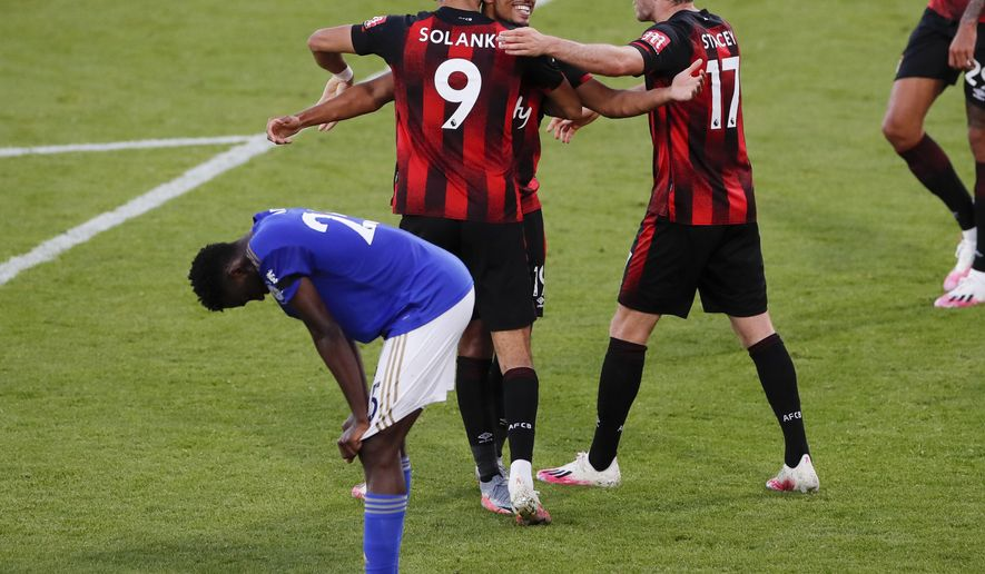 Bournemouth's Junior Stanislas, top centre, celebrates with teammates after their third goal during the English Premier League soccer match between Bournemouth and Leicester City at Vitality Stadium in Bournemouth, England, Sunday, July 12, 2020. (AP Photo/Andy Couldridge,Pool)