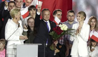 Incumbent President Andrzej Duda flashes a victory sign in Pultusk, Poland, Sunday, July 12, 2020. An exit poll in Poland's presidential runoff election shows a tight race that is too close to call between the conservative incumbent, Andrzej Duda, and the liberal Warsaw mayor, Rafal Trzaskowski.(AP Photo/Czarek Sokolowski)