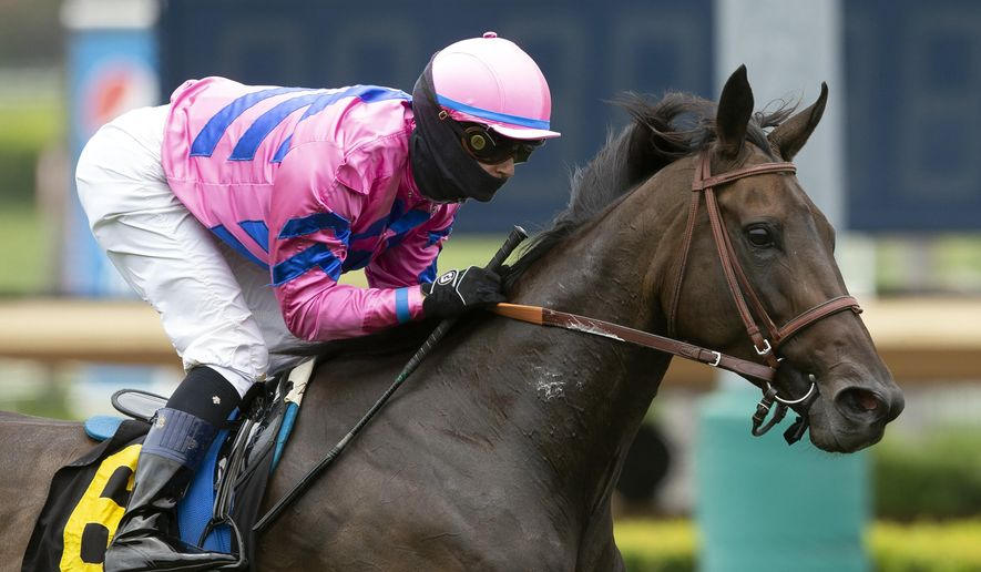 FILE - In this June 20, 2020, file photo provided by Benoit Photo, Toinette, with Flavien Prat aboard, wins the Grade III, $100,000 Wilshire Stakes horse race at Santa Anita in Arcadia, Calif. Prat has tested positive for COVID-19 after riding in Kentucky. Del Mar officials said Prat was tested Sunday, July 12, and was told shortly thereafter that he had a positive result. The 27-year-old jockey had been scheduled to ride eight horses at Del Mar on Sunday, but was removed from those mounts. He was in Kentucky to ride a day earlier. (Benoit Photo via AP, File)