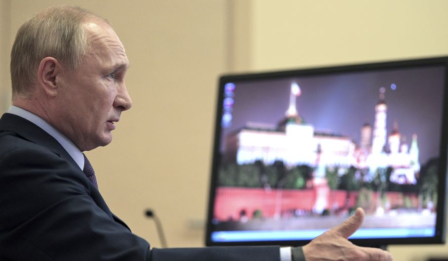 Russian President Vladimir Putin chairs a meeting with members of the Presidential Council for Strategic Development and National Projects via teleconference at the Novo-Ogaryovo residence outside Moscow, Russia, Monday, July 13, 2020. (Alexei Druzhinin, Sputnik, Kremlin Pool Photo via AP)
