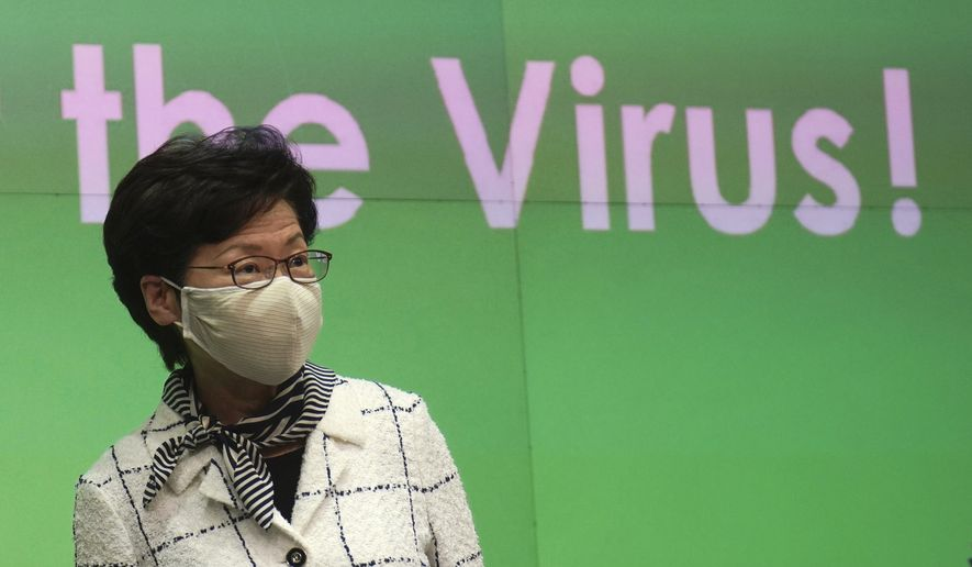 Hong Kong Chief Executive Carrie Lam arrives at a press conference in Hong Kong, Monday, July 13, 2020. Hong Kong on Monday introduced more stringent social-distancing measures, banning public gatherings of more than four and making it compulsory to wear a mask on public transport as the city battles a fresh outbreak of locally transmitted coronavirus infections. (AP Photo/Vincent Yu)