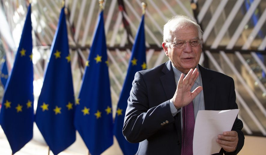 European Union foreign policy chief Josep Borrell reads a statement as he arrives for a meeting of EU foreign ministers at the European Council building in Brussels, Monday, July 13, 2020. European Union foreign ministers meet for the first time face-to-face since the pandemic lockdown and will assess their fraught relations with China and discuss the troubled relation with Turkey. (AP Photo/Virginia Mayo, Pool)/