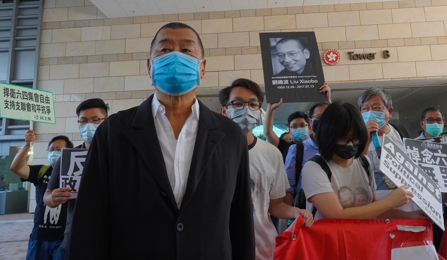 Hong Kong media tycoon Jimmy Lai, founder of the local newspaper Apple Daily, arrives outside a district court in Hong Kong, Monday, July 13, 2020. Activists including Lai who organized the June 4th Tiananmen massacre memorial this year, which was banned by police because of anti-virus social distancing reasons, had to make an appearance in court for charges for organizing and participating in the memorial. (AP Photo/Vincent Yu)