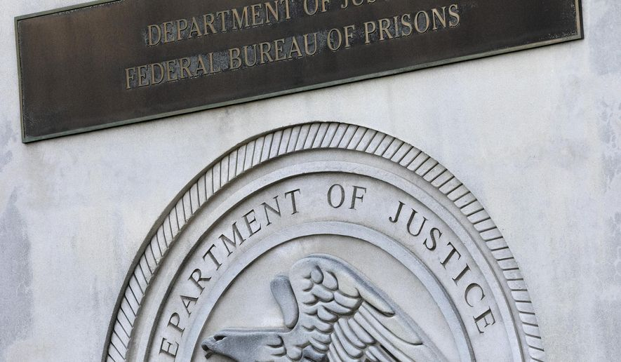 A sign for the Department of Justice Federal Bureau of Prisons is displayed at the Metropolitan Detention Center, Monday, July 6, 2020, in the Brooklyn borough of New York. Jeffrey Epstein's longtime confidante Ghislaine Maxwell has been transferred to New York to face charges she recruited women and girls for him to sexually abuse. The Bureau of Prisons confirmed that Maxwell was transferred Monday and is currently being held at the MDC. (AP Photo/Mark Lennihan)