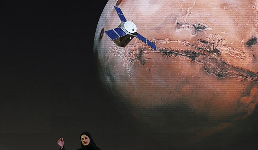 """In this Wednesday, May 6, 2015, file photo, Sarah Amiri, deputy project manager of the United Arab Emirates Mars mission, talks about the project named """"Hope,"""" or """"al-Amal"""" in Arabic, which is scheduled for launch in 2020, during a ceremony in Dubai, UAE. Three countries — the United States, China and the United Arab Emirates — are sending unmanned spacecraft to the red planet in quick succession beginning in July 2020. (AP Photo/Kamran Jebreili, File)"""