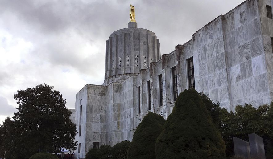 FILE - In this Jan. 11, 2018, file photo, clouds hover over the Oregon State Capitol in Salem, Ore. Acting quickly after the death of George Floyd, Oregon has publicly named bad apples among law enforcement, over 1,700 whose transgressions over the past 50 years were so serious that they were banned from working in law enforcement in the state. The online posting last week happened after the Oregon Legislature, meeting in special session last month, created a law requiring the Department of Public Safety Standards and Training to establish a statewide online public database of records for officers whose certification has been revoked or suspended. Some other states are moving in the same direction. (AP Photo/Andrew Selsky, File)