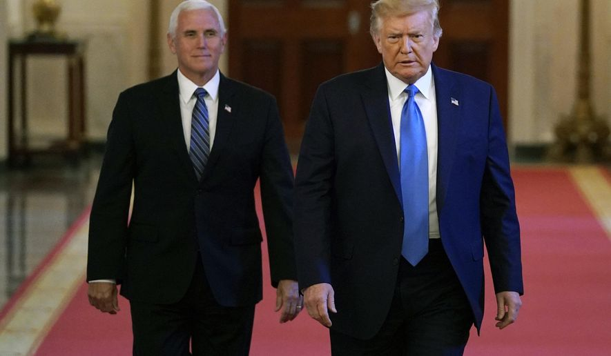 President Donald Trump and Vice President Mike Pence arrive to speak at a roundtable with people positively impacted by law enforcement, Monday, July 13, 2020, in Washington. (AP Photo/Evan Vucci)