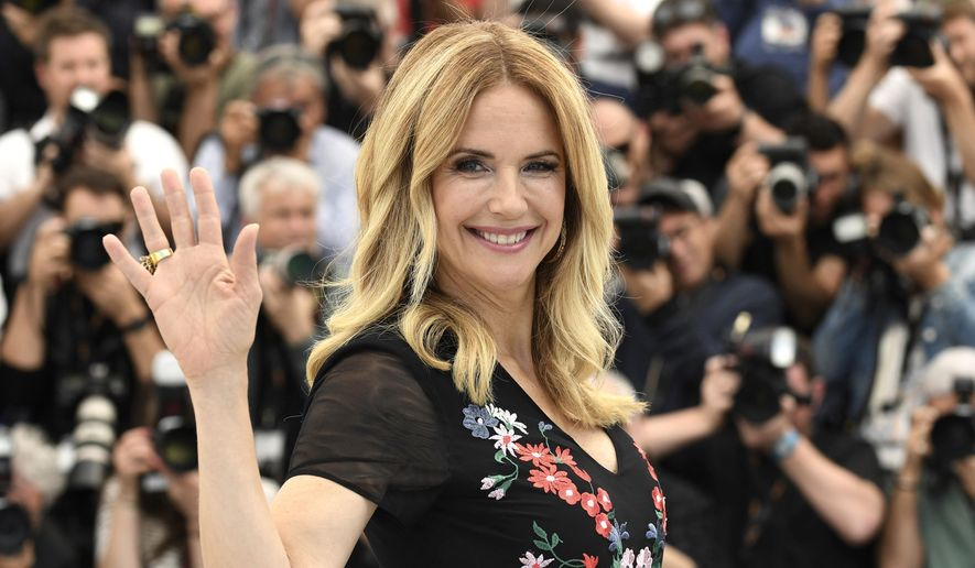 """In this May 15, 2018, file photo, actress Kelly Preston poses for photographers during a photo call for the film """"Gotti"""" at the 71st international film festival, Cannes, southern France. Actress Kelly Preston, whose credits included the films """"Twins"""" and """"Jerry Maguire,"""" died Sunday, July 12, 2020, her husband John Travolta said. She was 57. (Photo by Arthur Mola/Invision/AP, File)"""