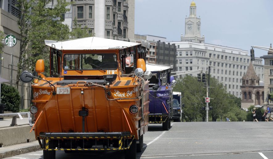 Boston's iconic duck boat tours started rolling again on Monday, July 13, 2020, as the city began Phase 3 of its coronavirus economic restart. Museums, movie theaters, historical sites and gyms in Boston were permitted to reopen Monday with certain restrictions, a week after most of the rest of Massachusetts. (AP Photo/Steven Senne)